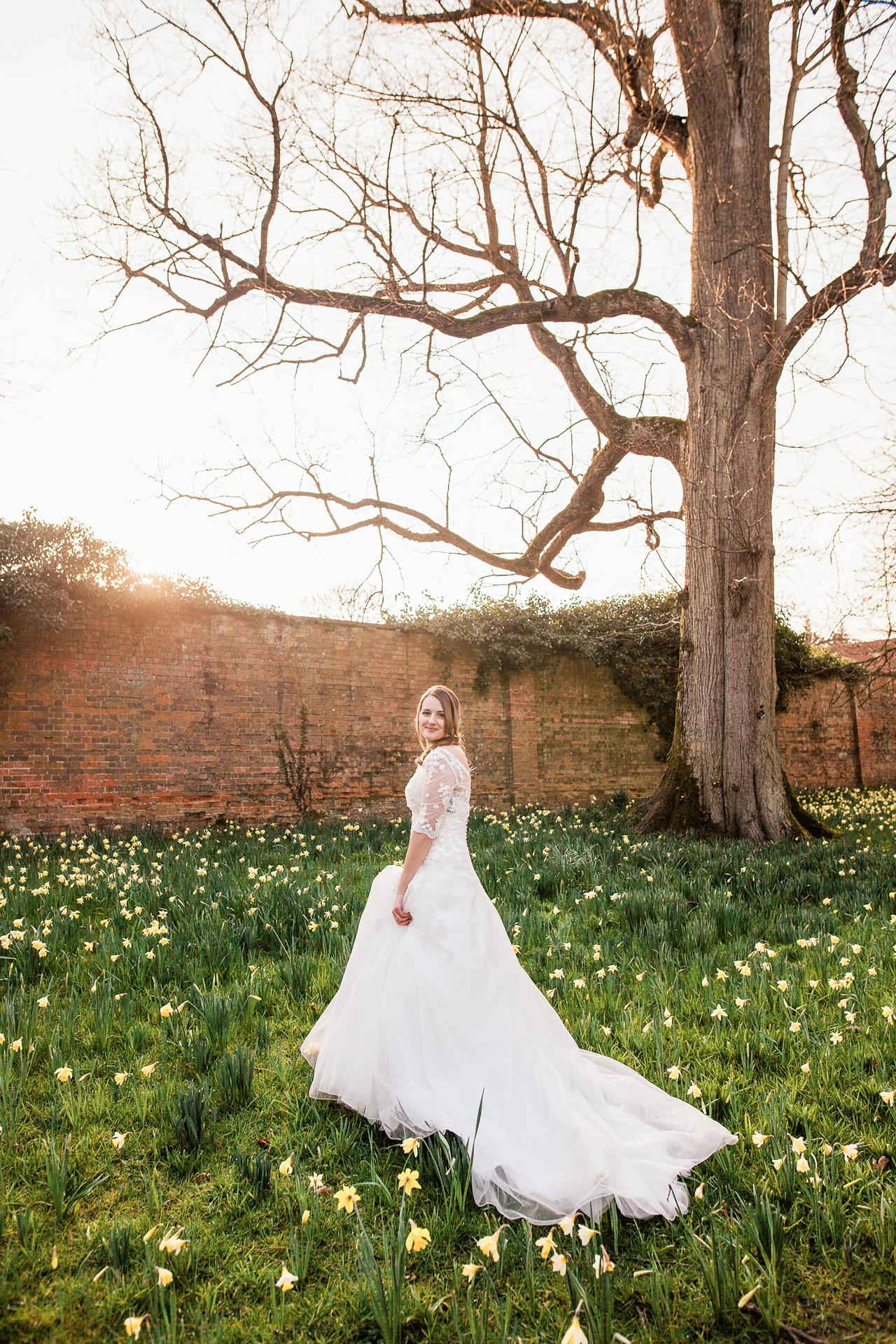 Bride in the hazy sunshine and spring flowers
