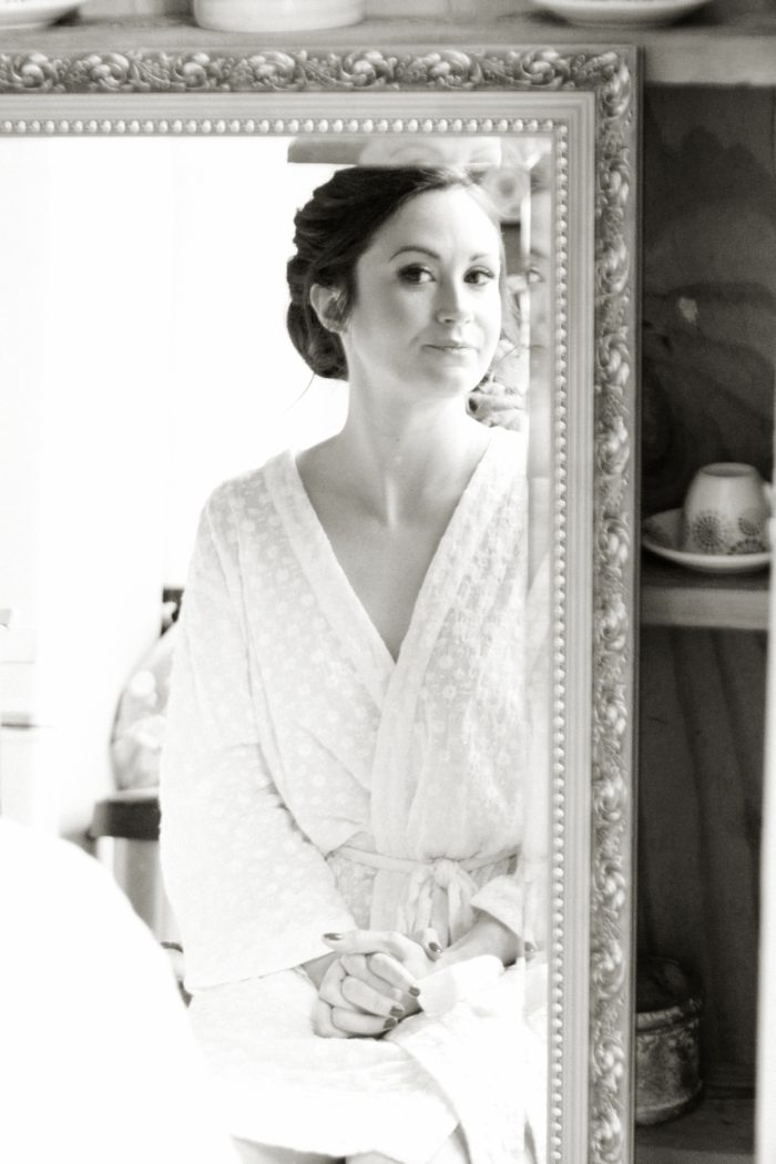 bridal prep looking in the mirror