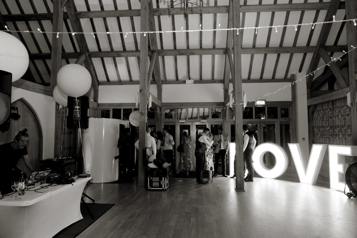 Illuminated LOVE letters wedding hire evening reception dance floor