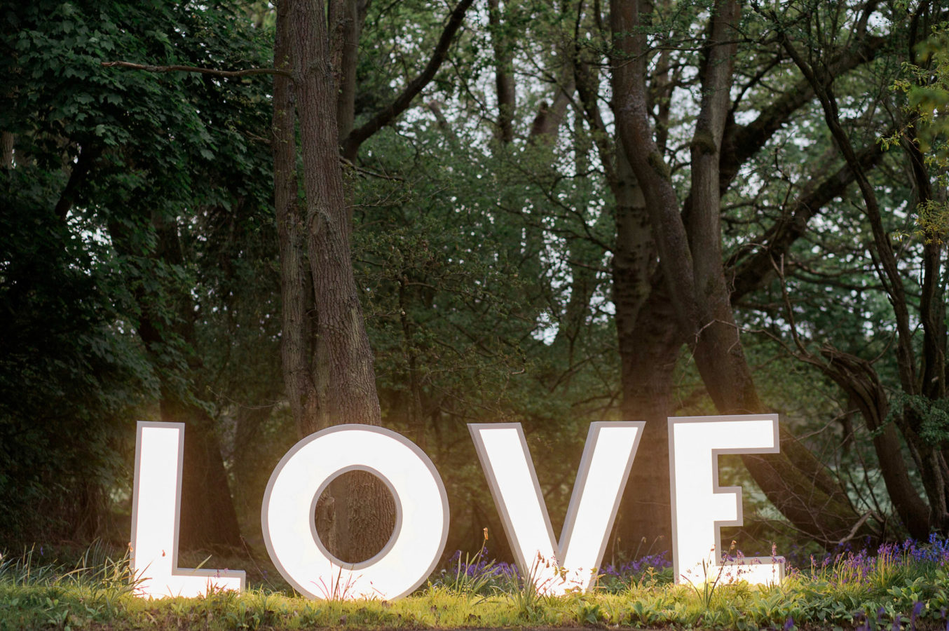 Illuminated LOVE letters wedding hire rustic set up