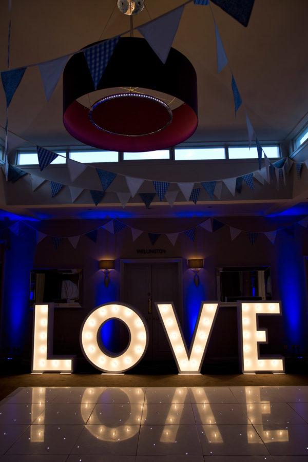 Illuminated LOVE letters wedding hire dance floor