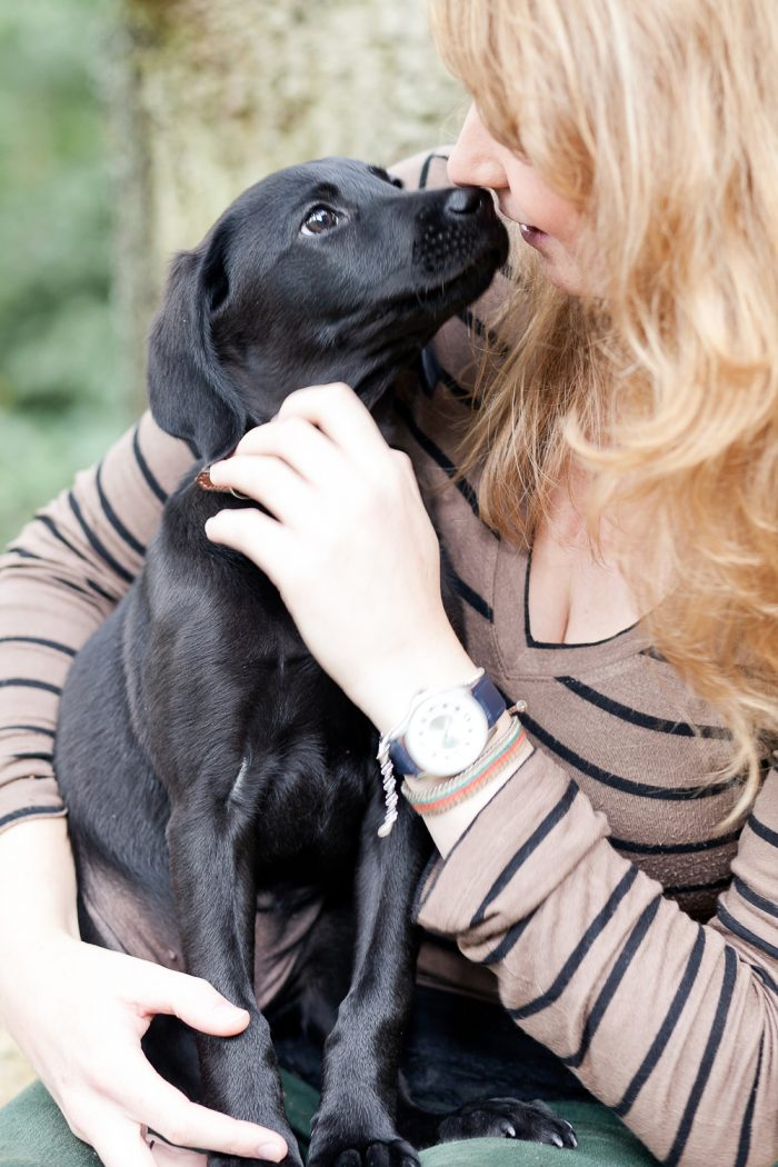 fine art lifestyle photography new puppy kisses together