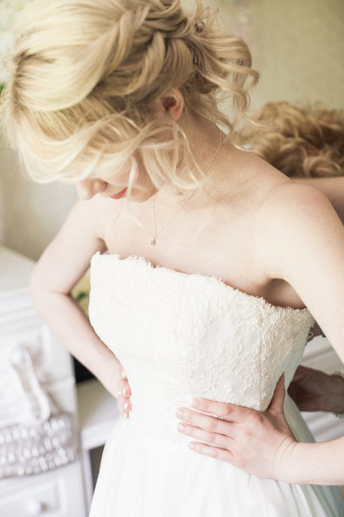 Fine Art Wedding Photography Beautiful Country Wedding lacing up the dress