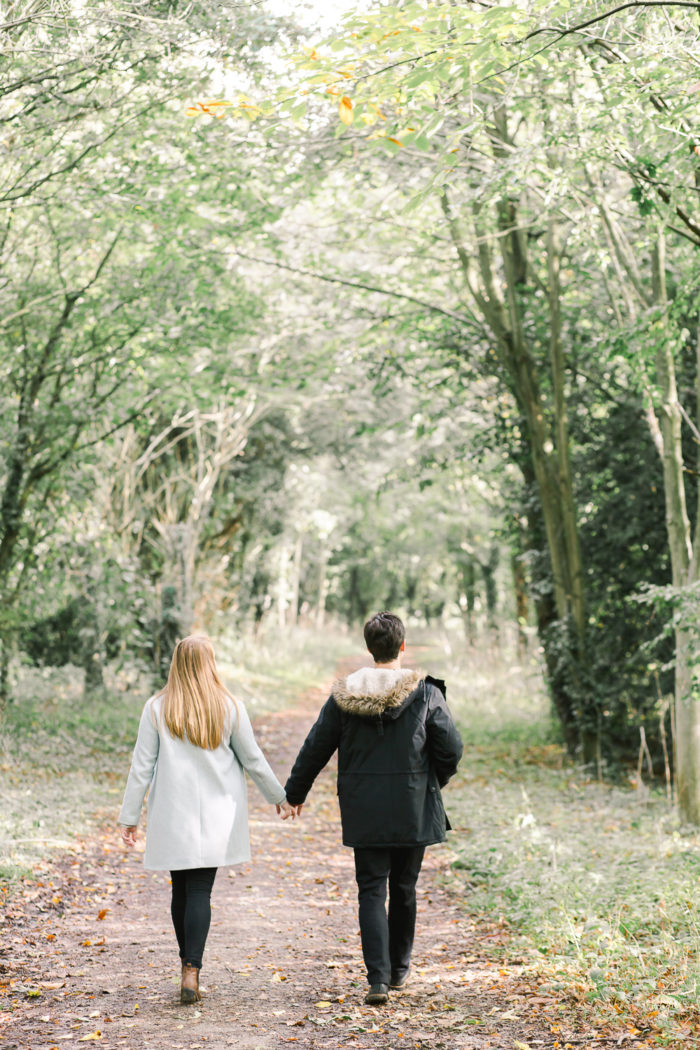 beautiful couple walking in forest
