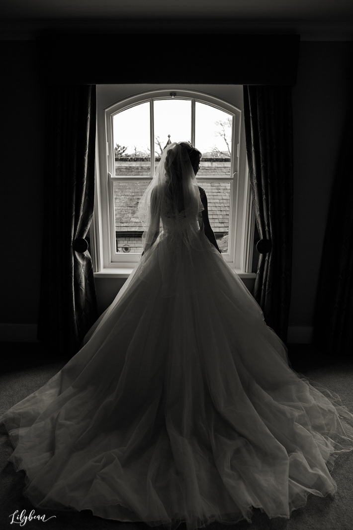 Bride in front of window during bridal prep