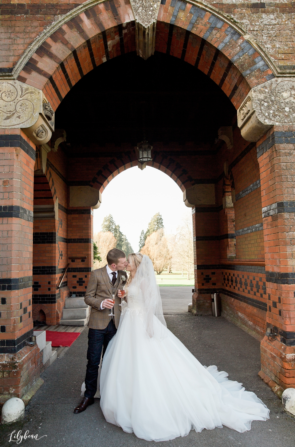 Bride & Groom in porch of The Elvetham