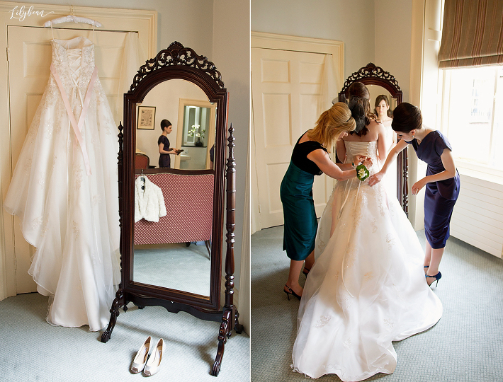 Bridal preparations with wedding dressing and bridesmaids