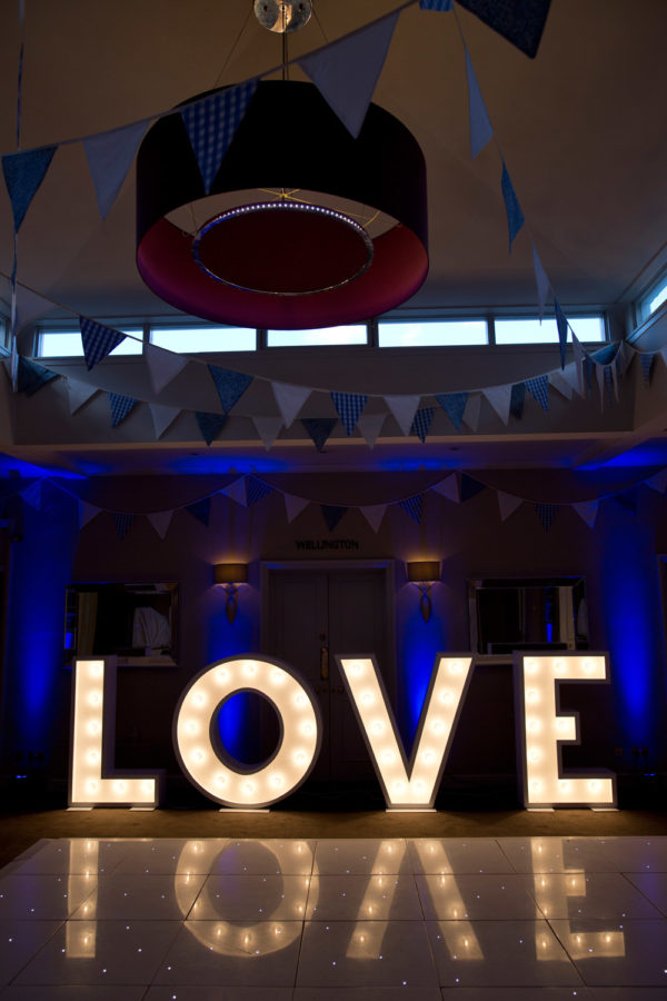Illuminated LOVE letters wedding hire dance floor