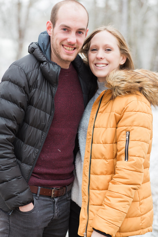 Woodland Engagement Shoot in snow couple portrait