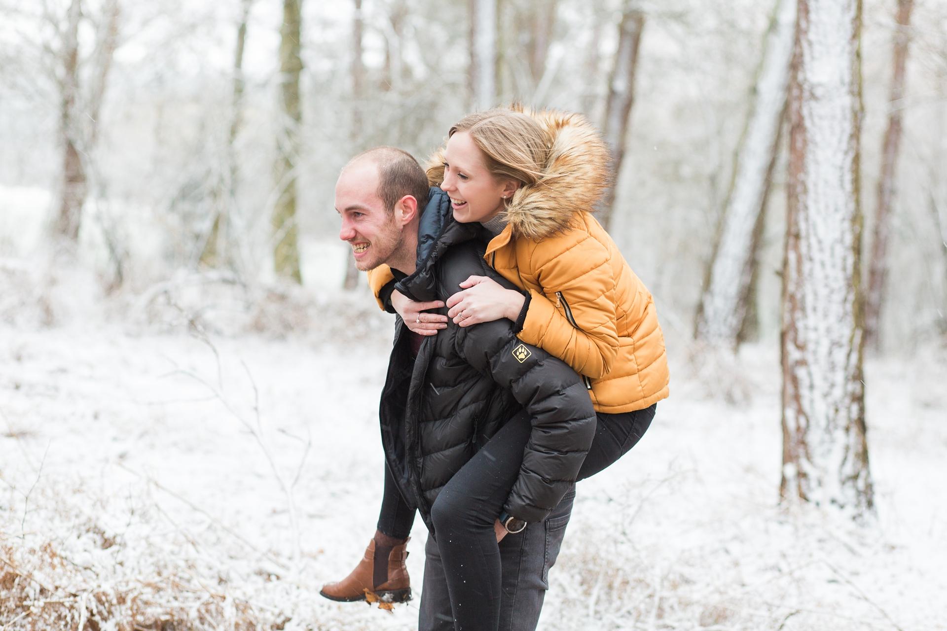 Woodland Engagement Shoot in snow piggyback fun