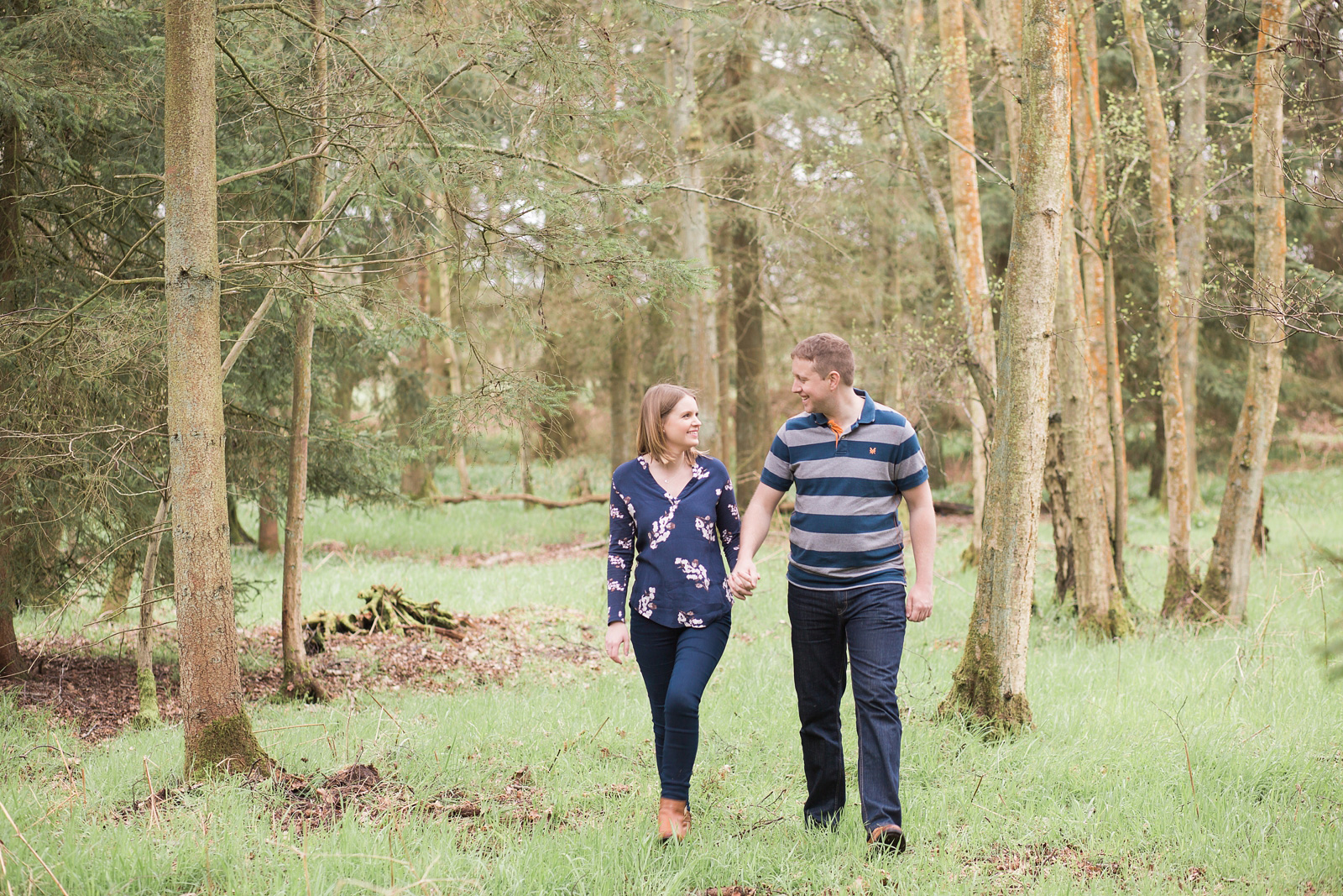Dreamy woodland engagement shoot walking in the woods