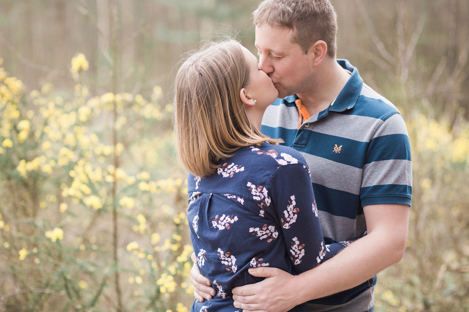 Dreamy woodland engagement shoot couple kissing