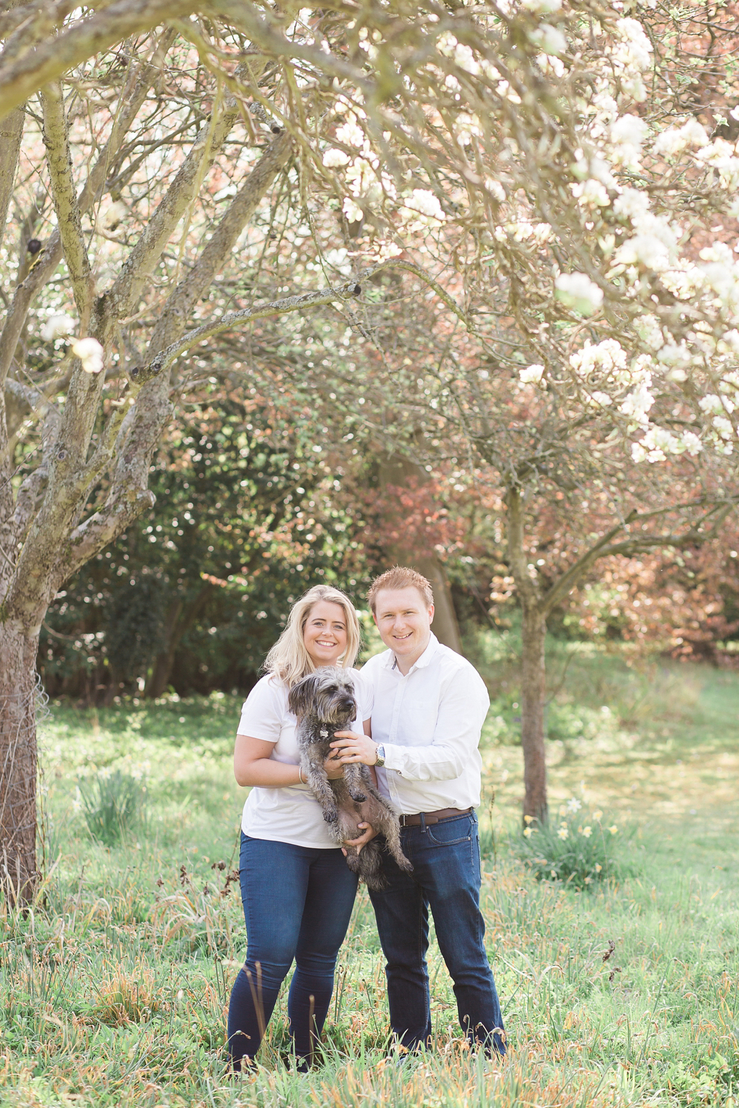 Engagement Shoot Spring Blossom Fine Art Wedding Photography Couple cuddling their dog